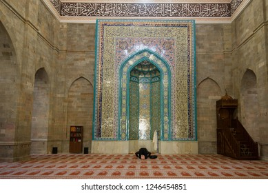 SHEMAHI, AZERBAIJAN - JANUARY 03, 2018: Prayer in the ancient Juma mosque