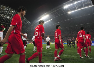 SHENYANG, CHINA - AUGUST 10:  The Chinese and Belgian teams enter the field for a match at the Beijing Olympic Games soccer tournament August 10, 2008 in Shenyang, China.