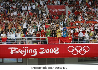 SHENYANG, CHINA - AUGUST 10:  Spectators cheer for the Chinese team prior to a Group C match between China and Belgium at the Olympic Games soccer tournament August 10, 2008 in Shenyang, China.