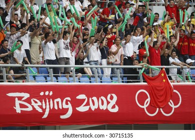 SHENYANG, CHINA - AUGUST 10:  Spectators cheer during a match between Brazil and New Zealand at the Beijing Olympic Games soccer tournament August 10, 2008 in Shenyang, China.  EDITORIAL USE ONLY.