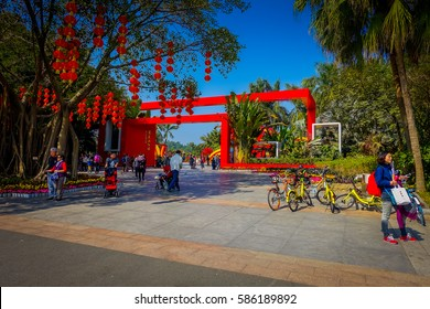 SHENZEN, CHINA - 29 JANUARY, 2017: Inner city streets with sorroundings, beautiful mix of traditional chinese and modern architecture, people shopping walking around, great blue sky