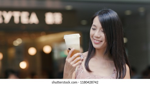 Shenzhen, china, 20 July 2018:- Woman drinking of cheese green tea at Heytea store in the city
