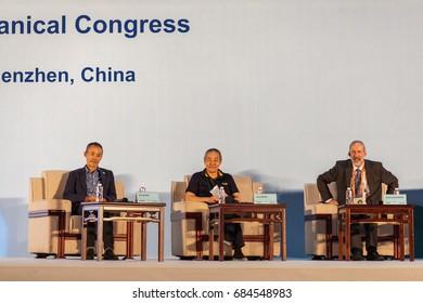 Shenzhen, China –July 23, 2017: Wang Shi, Wang Jian and Stephen Blackmore attends the conference forum during the XIX International Botanical Congress in Shenzhen, Guangdong, China.