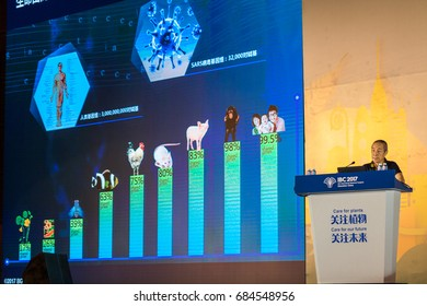 Shenzhen, China –July 23, 2017:Wang Jian(President of Beijing Genomics Institute) made a speech about Genetic engineering during the XIX International Botanical Congress in Shenzhen, Guangdong, China.