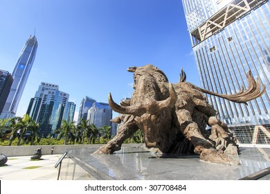 Shenzhen, China - August 19,2015: Stock market building in Shenzhen, with the copper bull statue on foreground. On background the tallest building of Shenzhen: the Ping An IFC