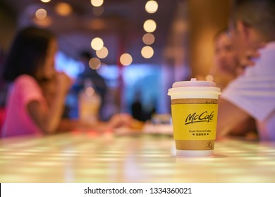 SHENZHEN, CHINA - CIRCA FEBRUARY, 2019: McCafe paper cup of a table at McDonald's restaurant.