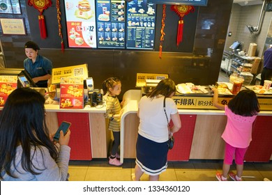 SHENZHEN, CHINA - CIRCA FEBRUARY, 2019: people at McDonald's restaurant.