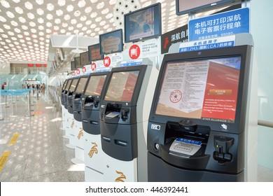 SHENZHEN, CHINA - CIRCA MAY, 2016: self check-in kiosks in Shenzhen Bao'an International Airport. It is located near Huangtian and Fuyong villages in Bao'an District, Shenzhen, Guangdong, China.