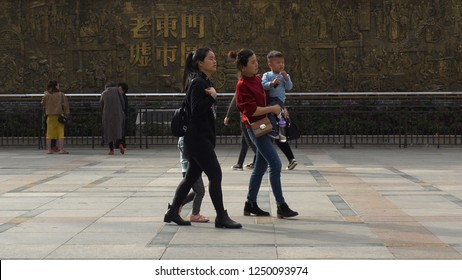 SHENZHEN, CHINA - CIRCA NOVEMBER 2018 : PARENTS and YOUNG CHILD at the street in Laojie area.