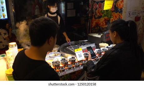 SHENZHEN, CHINA - CIRCA NOVEMBER 2018 : Customer doing payment at a shop via SMART PHONE.  Payment via smart phone becomes very common and popular in China.