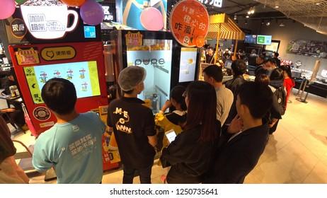 SHENZHEN, CHINA - CIRCA NOVEMBER 2018 : FRESH ORANGE JUICE VENDING MACHINE at HEMA SUPERMARKET in Shenzhen.