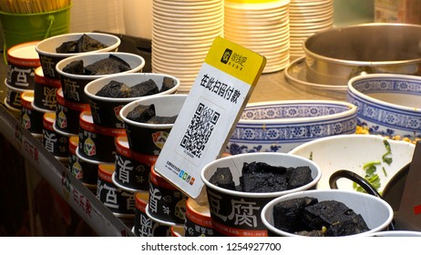 SHENZHEN, CHINA - CIRCA NOVEMBER 2018 : QR CODE to make a payment via smart phone.  At a shop in DONG MEN FOOD STREET in Laojie area.