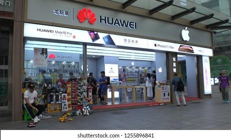 SHENZHEN, CHINA - CIRCA NOVEMBER 2018 : Store with HUAWEI LOGO and APPLE LOGO in HUAQIANGBEI area.