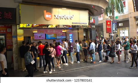 SHENZHEN, CHINA - CIRCA NOVEMBER 2018 : People making a LONG LINE at the DRINK SHOP in Laojie area.