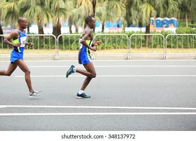 SHENZHEN, CHINA - DECEMBER 5: Marathon runners on the street at the third  Shenzhen International Marathon DECEMBER 5, 2015 in Shenzhen China