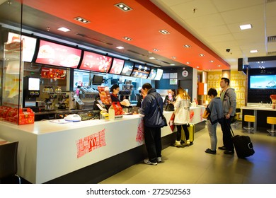 SHENZHEN, CHINA - FEBRUARY 16, 2015: McDonald's restaurant interior. The McDonald's Corporation is the world's largest chain of hamburger fast food restaurants