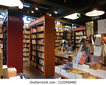Shenzhen, China - JULY 03, 2018: Bookshelves with books and customers of big and bright bookstore on JULY 03, 2018. Park  Books & Up Coffee in Shenzhen.