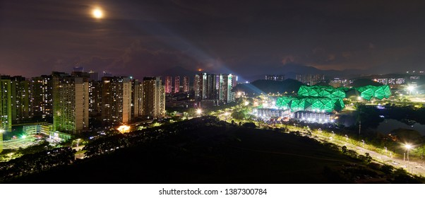Shenzhen / China - July 14 2016: Vibrant panoramic view of typical Chinese landscape with residential buildings and high ways in Shenzhen tonight