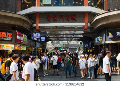 Shenzhen, China - July 16, 2018: Dong Men Pedestrian street in the old Shenzhen city area crowded with people on a sunny day