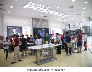 Shenzhen, China - Jun 13, 2016: People experience mobile devices of Huawei at an authorised mobile phone shop in Shenzhen city. The Chinese multinational company headquartered in Guangdong.