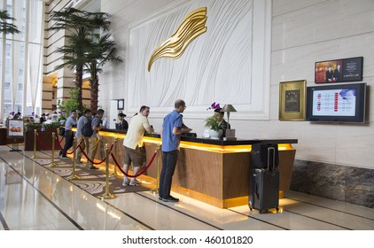 Shenzhen, China - Jun 14, 2016: Customers making check in procedure at the check in counter in lobby area of Grand Mercure Oriental Ginza Hotel.