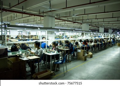 SHENZHEN, CHINA - MARCH 11: GO-ON earphone factory produces wireless earphones - 2,4GHz and RF/UHF system which works even 100 meters away from transmitter. Assembly line on March 11, 2011 in Shenzhen, China.