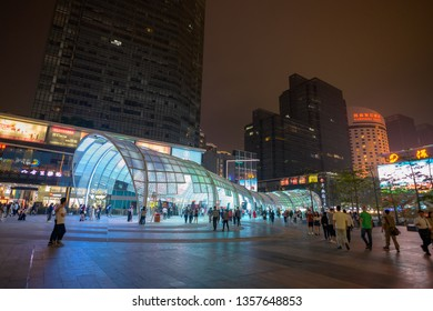 ShenZhen, China, March 31, 2019: Shenzhen Bay Ave. at nighttime. Shenzhen Bay ave is a famous place for retail shopping, dining and leisure destination located in downtown Nanshan District
