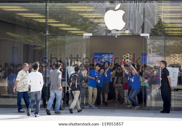 SHENZHEN, CHINA - NOV. 3:  Customers walking into the new Apple store. Apple open its seventh Apple store in mainland China, located in SHENZHEN, November 3, 2012.