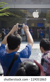 SHENZHEN, CHINA - NOV. 3: A man used iphone to take picture for the apple store. Apple open its seventh Apple store in mainland China, located in SHENZHEN, November 3, 2012.