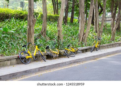 Shenzhen, China - November 14, 2018: Yellow bicycles of a bicycle sharing company are carelessly parked in street. Too easy and too cheap use of the shared resources leads to disorder.