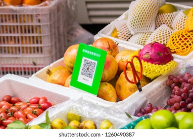 Shenzhen, China - November 14 2018:  Qr codes for cashless payment with smart phones in front of a street fruit booth. Digitalization, such as cashless payment, in daily life is being widely accepted.