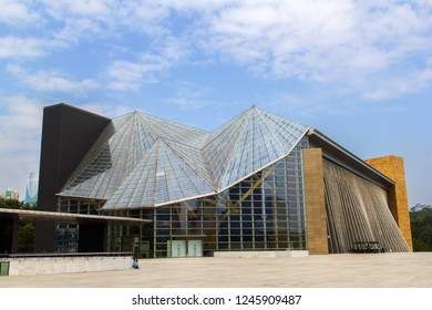 Shenzhen, China - November 24 2018: the exterior structure of the Music and Library hall in the Shenzhen city center. It is a modern architecture out of steel and glass structure.