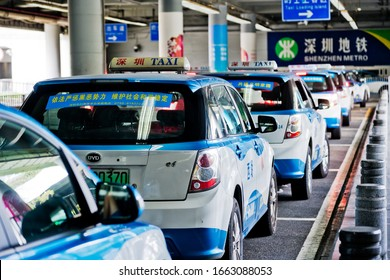 Shenzhen, China - October 22, 2019: Long line of BYD Electric taxis waiting near train station. The ultra modern city with 15 million people is located in southern China.