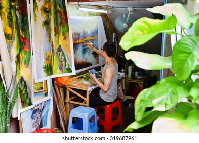 SHENZHEN, CHINA- SEPTEMBER 8: young artist of the Dafen Village at work in Shenzhen, Guangdong, China on September 8, 2015. They specialised in the making of replicas of oil paintings.