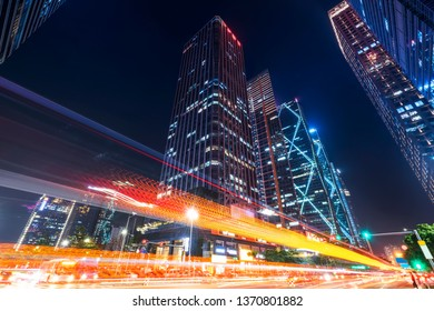 Shenzhen city buildings at night and blurred car lights