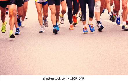 SHENZHEN - DEC 08: Unidentified athletes running at the shenzhen international marathon 2013, shennan road,shenzhen city,China,on DEC 08,2013 at Shenzhen city,Guangdong province,China.