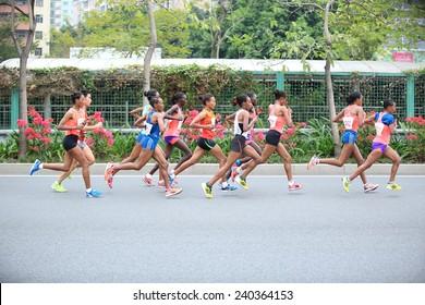SHENZHEN,CHINA - DECEMBER 7: Unidentified marathon runners on the street at Shenzhen International Marathon DECEMBER 7, 2014 in Shenzhen, China