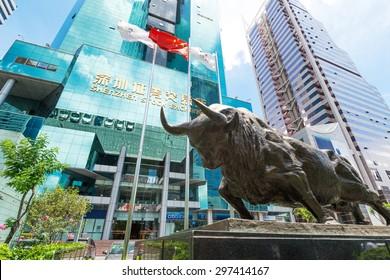 Shenzhen,China-June 15,2015: Shenzhen stock market building and bull sculpture
