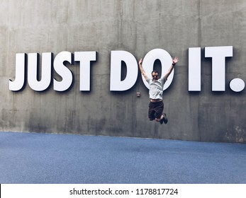 Shenzhen,Guangdong,China.June 2nd,2018.A Caucasian man jumping in front of big just do it sign on the wall  in shenzhen Guangdong province China.
