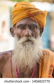 Sheoganj, India - April 29, 2014: Sadhu stand at front of shop in sheoganj market for collecting money to Life manipulator, sadhu always walk one village to another village's market for collect money