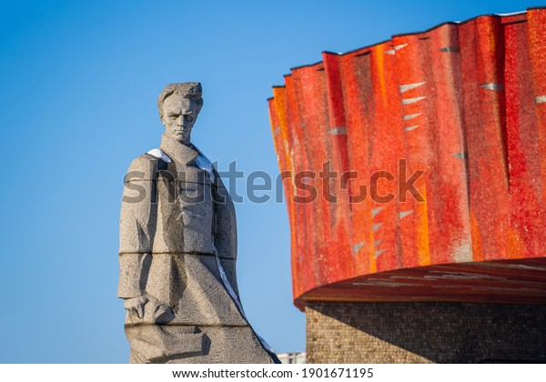 Shepetivka, Ukraine - january 21, 2021 : Monument to soviet realist writer Nikolai Ostrovsky in Shepetivka, Ukraine. Statue of Nikolai Ostrovsky against the blue sky