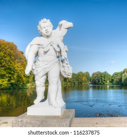 Shepherd sculpture in front of the lake at the Schloss Charlotte
