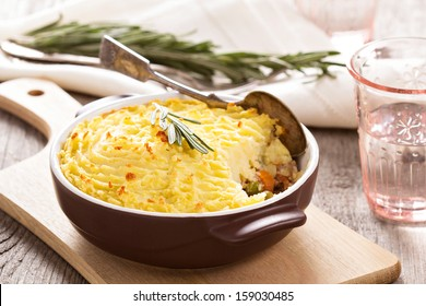 Shepherd's pie (baked mashed potatoes and ground beef with vegetables)