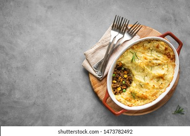 Shepherd's Pie with ground beef, potato and cheese on grey background, top view, copy space. Traditional homemade casserole - Shepherds Pie.