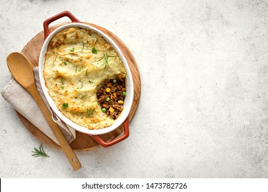 Shepherd's Pie with ground beef, potato and cheese on white background, top view, copy space. Traditional homemade casserole - Shepherds Pie.