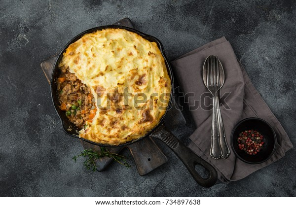 shepherd's pie. Minced meat, mashed potatoes and vegetables casserole in cast iron pan. Top view