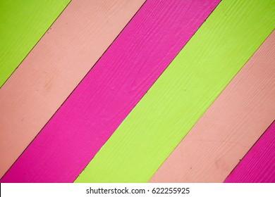 Shera wood paneling, green, purple, pink background.