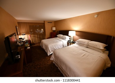Sheraton Vancouver Airport Hotel, Vancouver, US. 30 Apr, 2018 - Interior of the Junior Suites room. Two huge beds with TV and a working desk.