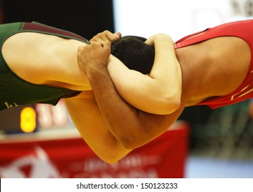 SHERBROOKE, CANADA - August 7: Two male wrestlers in a headlock at the Canada Games August 7, 2013 in Sherbrooke, Canada.
