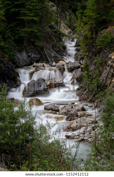 Sherbrooke Creek runs peacefully beside the road in Yoho National Park